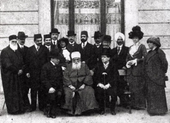 'Abdu'l-Bahá in Budapest with His companions, hosts and journalists in front of Hotel Ritz (Published in Érdekes Újság, 10 April 1913)